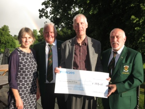 Presentation of a cheque to Lisburn Outlook by Edenmore Golf Club