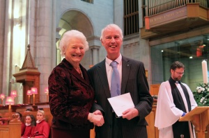 David Mann (Secretary of Lisburn Outlook) receiving a cheque from Dame Mary Peters at Belfast Cathedral (5th February 2017)